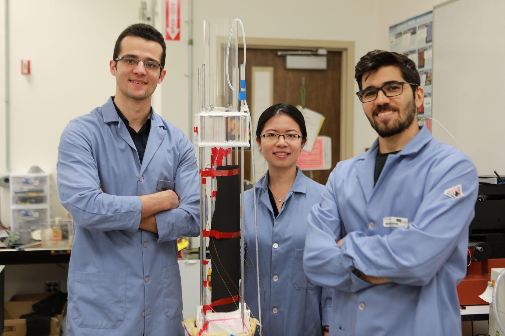 UCLA researchers (from left) Abolfazl Sadeghpour, Hangjie Ji and Navid Dehdari Ebrahimi with their experimental water capture apparatus / Photo credits: UCLA Newsroom